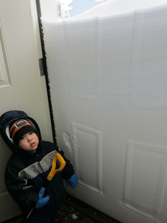 The snow drifts on the other side of the garage door were not as fun.  They were a barricade that had to be shoveled away.