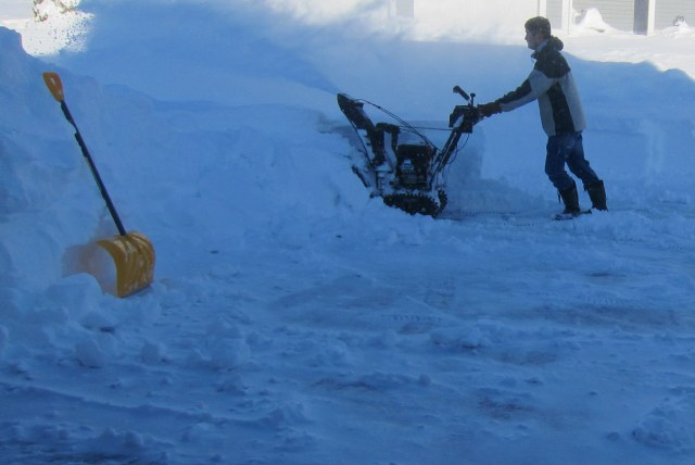 And then back to work clearing the snow.  This time aided by the snow blower.  We hope to reach the street by tomorrow.